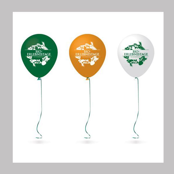 Drei Luftballons grün orange weiß